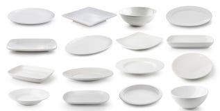 Vit keramikplatta och bunke som isoleras på vit bakgrund Arkivbild