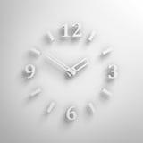 Vit klockaframsida på väggen med skugga stock illustrationer