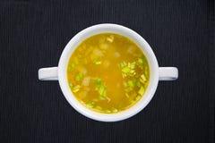 Vit kopp med soppa Royaltyfria Foton