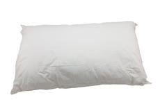 Vit kudde på vit bakgrund Arkivfoto