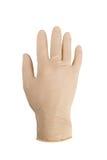 Vit latexhandske på en isolerad manlig hand Royaltyfri Foto
