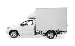 Vit leveranslastbil med tomma sidor som är klara för beställnings- text eller l Royaltyfria Foton