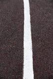 Vit linje på en stadion Royaltyfria Bilder