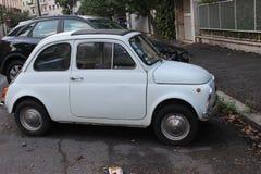 Vit liten retro bil royaltyfri foto