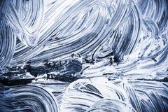 Vit målarfärg över mörker - blått exponeringsglas Royaltyfri Foto