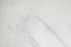 Vit murbrukvägg med stuckaturlagertextur, bakgrund Arkivfoto