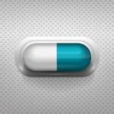Vit- och blåttkapselpreventivpiller med bakgrund Royaltyfria Foton
