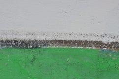 Vit- och gräsplanmålarfärg Royaltyfri Foto