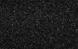 Vit- och grå färgfläck på svart bakgrund fotografering för bildbyråer