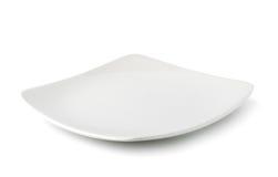 Vit platta på vit bakgrund Arkivbild