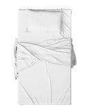 Vit säng i tomt utrymme som isoleras på vit bakgrund, framför fotografering för bildbyråer