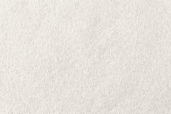 Vit sandbakgrund Royaltyfria Bilder