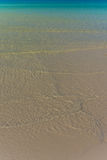 Vit sandig strand med stillhetfrikändhavet Fotografering för Bildbyråer