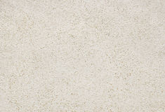 Vit sandstrand för bakgrund och textur Royaltyfria Bilder