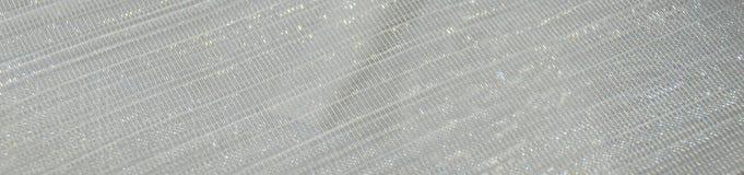 Vit skinande paljetttextilbakgrund Royaltyfria Bilder