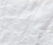 Vit skrynklig textur för bakgrund för silkespapperpapper Arkivbilder