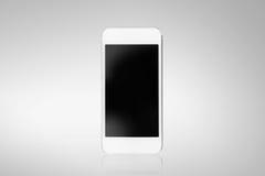 Vit smartphone på en grå bakgrund Fotografering för Bildbyråer