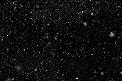 Vit snö på svart bakgrund Arkivfoto