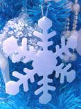 Vit snöflinga för garnering Arkivbilder