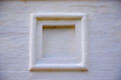 Vit stenvägg för fyrkantig ram Arkivfoto