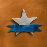 Vit stjärna på guld- bakgrund Royaltyfri Foto