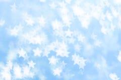 Vit stjärnabokeh på blå bakgrund Royaltyfri Foto