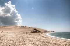 Vit strand med molnet på den Bazaruto ön Royaltyfri Bild