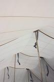 Vit tälttakinre med guld- Poles och flaggaskuggor - 2 Fotografering för Bildbyråer