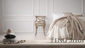 Vit tabellhylla med kiselstenjämvikt och bokstäver som 3d gör ordfengshuien över klassiskt sovrum för evintage med mjuk säng full royaltyfria bilder