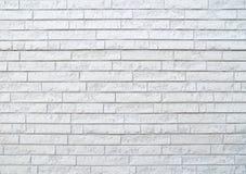 Vit tegelstenvägg för modern sten arkivbilder