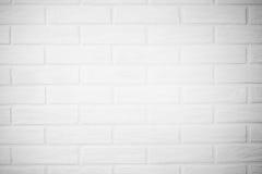 Vit tegelstenvägg med skuggahorisontalfototapeten i Royaltyfri Foto