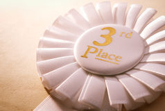 vit vinnarerosett för 3rd ställe Arkivfoto