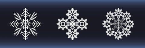 vita blåa snowflakes för bakgrund Arkivbilder