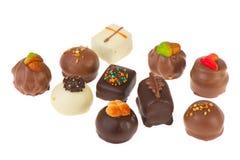 vita bruna choklader Arkivfoto