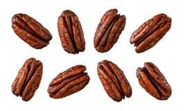 vita caramelized isolerade pecannötter Fotografering för Bildbyråer