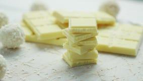 Vita choklad och sötsaker arkivfilmer