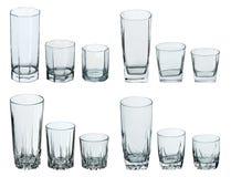 vita drinkexponeringsglas som ställs in Arkivfoton