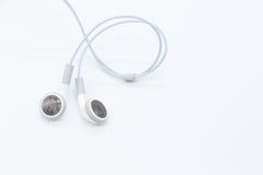 Vita earbuds Arkivfoto