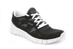 vita enkla sportar för svart sko royaltyfria foton