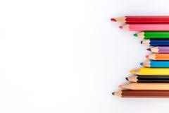 vita färgrika blyertspennor för bakgrund Dra tillbaka till skolafoto Royaltyfria Bilder