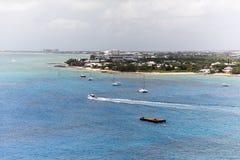 Vita fartyg på det blåa havet Fotografering för Bildbyråer