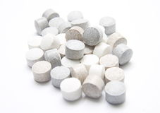 vita gråa pills Royaltyfri Foto
