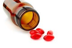 vita isolerade pills Arkivbilder
