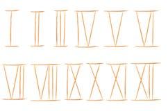 vita isolerade tandpetarear och numeriskt gammalt roman antikt alfabet Royaltyfria Foton