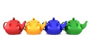 vita isolerade teapots för färg fyra royaltyfri fotografi