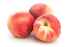 vita persikor Arkivfoton