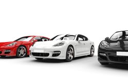 Vita röda och svarta bilar Arkivbilder