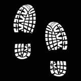 Vita spår från skor på en svart bakgrund Royaltyfri Fotografi