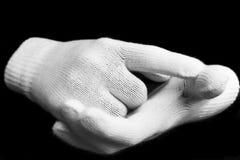 vita svarta handskar Arkivfoto