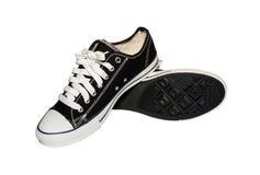 vita svarta skor för bakgrund Royaltyfri Foto